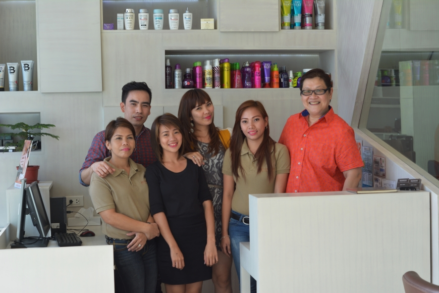 The great staff at Hombre Salon with owner Jen Leung (far right).