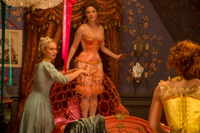 Lily James is Cinderella, Holliday Grainger is Anastasia and Sophie McShera is Drisella in Disney's live-action feature inspired by the classic fairy tale, CINDERELLA, which brings to life the timeless images from Disney's 1950 animated masterpiece as fully-realized characters in a visually dazzling spectacle for a whole new generation.